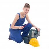 Young Attractive Woman Builder In Workwear With Toolbox Isolated On White
