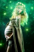 Portrait of a primeval pregnant woman. Ancient times. Fantasy.