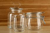 Set of empty glassware on wooden background