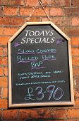 picture of baps  - Todays Special chalkboard against a brick wall advertising Pulled Pork Bap - JPG