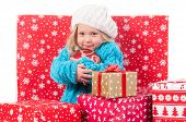 Funny little girl around christmas gift boxes