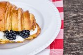 Delicious Croissant With Cream And Blueberries. For Breakfast.