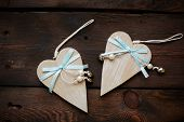 Wooden hearts with blue ribbons and pearls