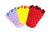 colourful female socks, over white