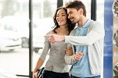 foto of rental agreement  - Beautiful young couple in the showroom choosing a car - JPG