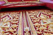 Thailand Traditional Angel Sculpture On Temple's Door