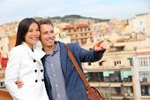 image of lovers  - Romantic happy urban couple looking at view of Barcelona - JPG