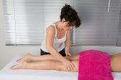 At A Spa Center A Woman  Receiving A Massage On Her Leg