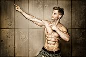 picture of abdominal muscle man  - Posing young well trained man with perfect abdominal and pectoral muscle - JPG