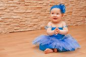 picture of tutu  - Portrait of an adorable baby girl playing dress up wearing a ballet tutu - JPG