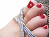 Womans Foot In The Footwear With Decorated Painted Nails