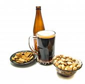 Beer In Glass And Different Snacks