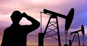 industry, oilfield, people and development concept - black silhouette of oil worker and pump jack
