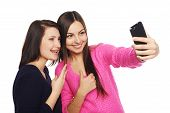 foto of two women taking cell phone  - Two girls friends taking selfie with smartphone - JPG