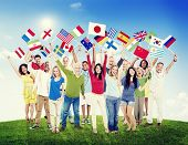 Multi-Ethnic Group of People Holding National Flags Friendship Concept