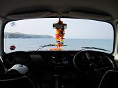 picture of campervan  - A camper van overlooking the sea from the interior - JPG