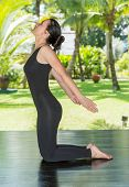 foto of pilates  - Young woman is practicing yoga and pilates on nature - JPG