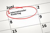 An image of a calendar detail shows June the 1st international Childrens Day in german language