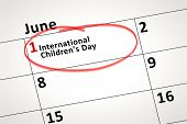 An image of a calendar detail shows June the 1st international Childrens Day