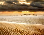 View Of Sand Dunes And Dunes In The Sahara Desert At Sunset