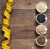 picture of legume  - Cereals and legumes in bowls on a wooden table - JPG