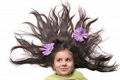 Little Girl With Fanned Hair And Flowers