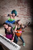 stock photo of groupies  - Young all girl punk rock band performing - JPG