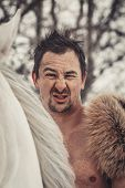 picture of beast-man  - Portrait of a wild man at winter day - JPG