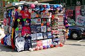 Street vendor offers various colorful souvenirs