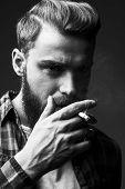 Bearded Man Smoking.