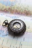 Old  Pocket Watch On  Map