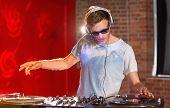 Cool dj spinning the decks at the nightclub