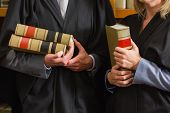 Lawyers holding books in the law library at the university