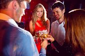 Happy friends toasting with champagne at the nightclub