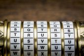 stock photo of trust  - trust word as a password to combination puzzle box with rings of letters - JPG