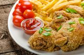picture of fried chicken  - Fried chicken chilli fries and dip and spring onions on top of meal - JPG