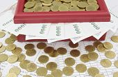 Gold Coins And Bill On Red Treasure Box