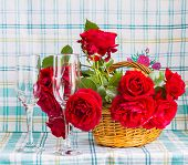 Red Roses In A Basket And Two Glasses