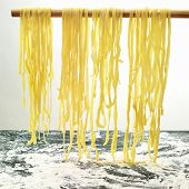 Pasta Hanging To Dry In The Kitchen