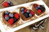 Plate of chocolate heart dessert cups with fruit