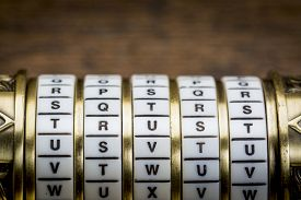 foto of combinations  - trust word as a password to combination puzzle box with rings of letters - JPG