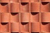 image of cylinder  - A beautiful brick color in a cement wall - JPG