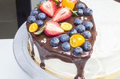stock photo of kumquat  - Cake with strawberries, blueberries, kumquat drizzled with chocolate ** Note: Visible grain at 100%, best at smaller sizes - JPG