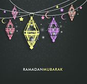 image of ramadan mubarak  - Beautiful Elegant Ramadan Mubarak Lanterns or Fanous Hanging With Colorful Lights in Islamic Pattern Background for the Holy Month Occasion of fasting - JPG