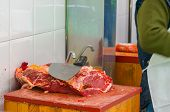 foto of slaughterhouse  - Butcher knife in the butchery. Raw meat preparation