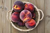 stock photo of peach  - Peach on wooden table Nutritious and healthy food - JPG