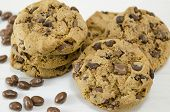 stock photo of chocolate-chip  - Chocolate chip cookies and chocolate grains on white - JPG
