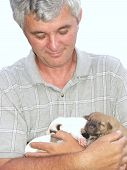 Mature Man Holding Puppies