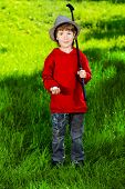 stock photo of 7-year-old  - Cute 7 years old boy playing golf outdoor - JPG