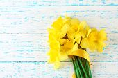 image of daffodils  - Beautiful bouquet of yellow daffodils on wooden background - JPG